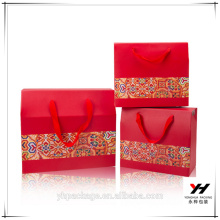 2016 custom printed cheap price packaging wedding candy red paper gift bag