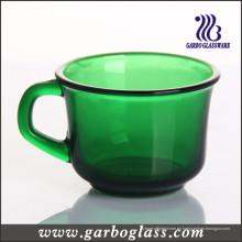 Taza de color sólido verde con forma popular
