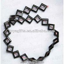 Perles de Rhombus magnétiques d'hématite 12MM 16 po