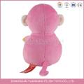 Guangdong rellenó el mono rosado con el juguete de peluche del plátano