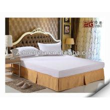 Saias decorativas de cama amarela com lençol