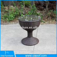 Modern outdoor round coffee table with glass on top