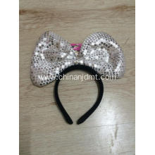 A headband with a big bow