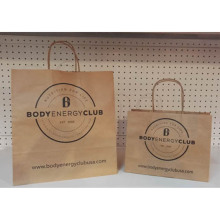Shopping bag con torsione in carta Kraft