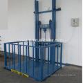 Elevador de carga fixado na parede da plataforma do elevador do trilho de guia da altura da carga de 3m-15m 3000kg-3t