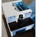 Automatische knopverpakkings- en knoopmachine