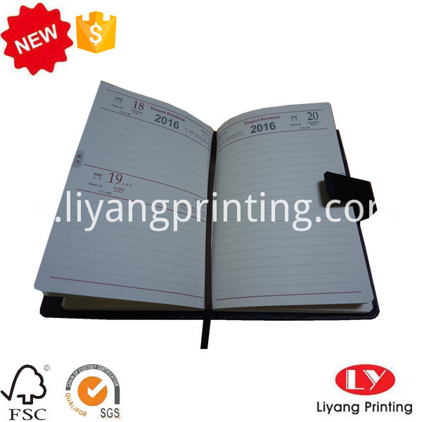 notebook with ribbon