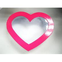 Caixa de papelão rosa coração forma com janela clara