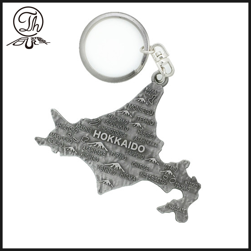 map shape metal keyring