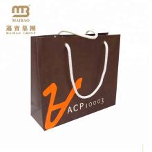 O projeto justo do OEM da feira profissional personalizou sacos de papel da propaganda da impressão com punhos