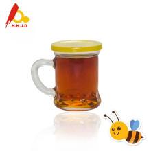 Miel de abeja longan pura en frascos de vidrio