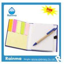 Caderno de papel com etiquetas coloridas do planejador672