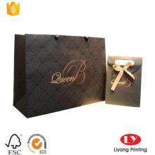 Элегантный штамповочный бумажный подарочный пакет с логотипом оптом