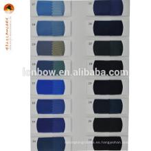 Tejido de forro interior PV blanco para la ropa de stock regular