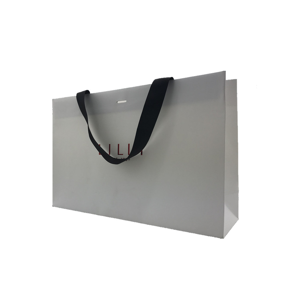Corrugated paper gift containing shopping bag