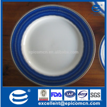 white dinnerware dishes with blue borders rim blue serving platters