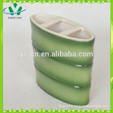 green hotel toothbrush holder with bamboo design