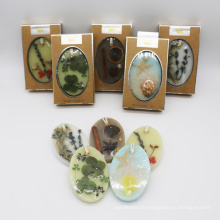 oval scented wax hanging sachet with nature decoration in kraft box