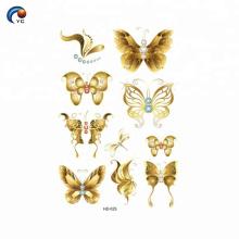 Tatuaje encantador de oro y CMYK mariposa