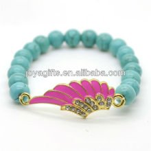 Turquoise 8MM Round Beads Stretch Gemstone Bracelet with Diamante alloy Wing Piece