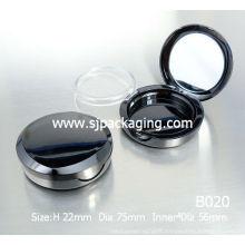 empty compact powder container