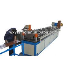 Machine de formage de rouleaux de toitures et de panneaux muraux