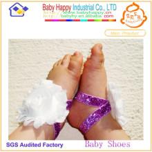 Zapatos de bebé vendedores calientes del cordón de la flor