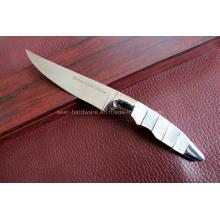 Couteau de table à poignée de coquilles (SE-0461)
