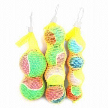 Colorful tennis balls in net bag, used for any ground