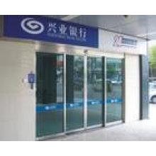 Système automatique de porte de cabine bancaire