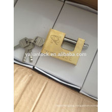 gold coated rectangular padlock fixed with vane key