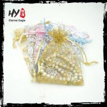 Marque nouveau logo disponible poche de bijoux de velours snap, pochette de bijoux doux, personnalisé bijoux imprimés sacs avec un grand prix