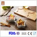 Los tapas de cerámica blancos de la forma de la estrella de la venta caliente fijaron con la bandeja de bambú