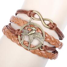 As pulseiras de infinito de aves Hunger Games luz DIY metal bronze antigo de pulseira de couro marrom quente vendendo pulseiras atacado