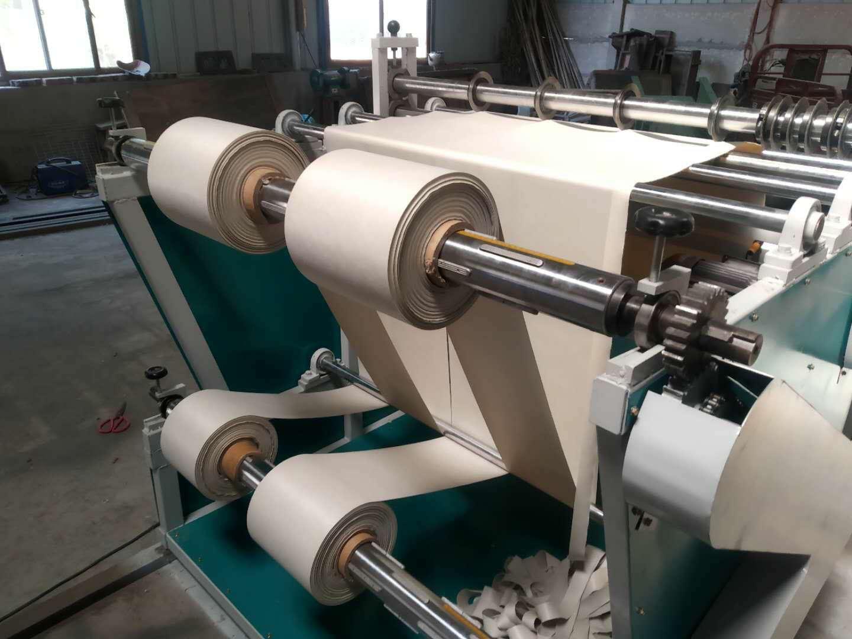 Meltblown fabric slitting and rewinding machine