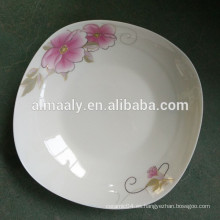 Placas cuadradas de cerámica con flor dorada