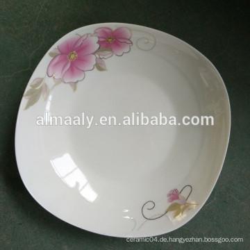 Quadratische keramische Platten mit goldener Blume