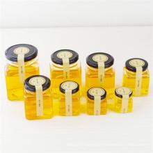 Biscuits en verre carré pour le miel, la nourriture, la crème, les bouteilles de stockage de verre