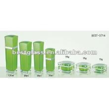 botella de acrílico verde pétalo y tarro de acrílico