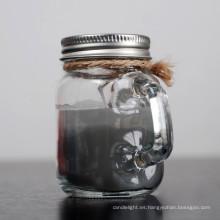 Vela de tarro de masón con aroma a parafina y nueces