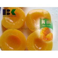 Função polivalente do pêssego amarelo enlatado em xarope