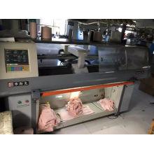 Machine à tricoter informatisée d'occasion / seconde main