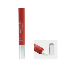Squeeze plastic lip gloss cosmetic tube with brush applicator