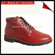 Piquer les chaussures en cuir de construction