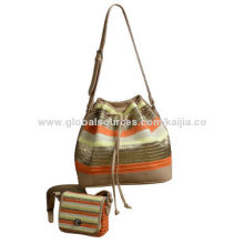 Women's straw drawstring bag in metallic effect strips, suitable for summer outing