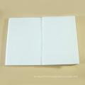 Le cahier à spirale réutilisé d'Eco avec le papier jaune, papier de cahier en gros d'étudiant