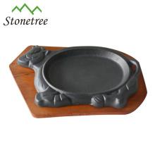 """8,5 """"bandeja crepitante do ferro fundido vegetal do óleo da forma da vaca com base"""