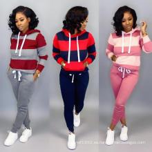 Jersey de manga larga de patchwork a rayas y pantalones pitillo