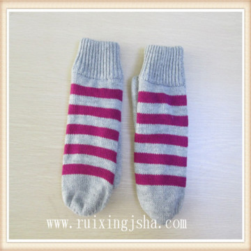 women knitted stripped mittens