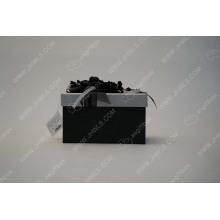 A modest ribbon flower gift box